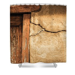 Shower Curtain featuring the photograph Cracked Lime Stone Wall And Detail Of An Old Wooden Door by Semmick Photo
