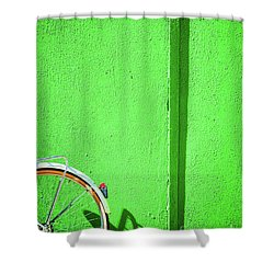 Shower Curtain featuring the photograph Green Wall And Bicycle Wheel by Silvia Ganora