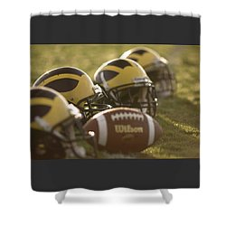 Shower Curtain featuring the photograph Helmets And A Football On The Field At Dawn by Michigan Helmet