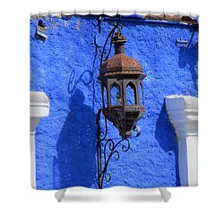 Lantern On Blue Wall Shower Curtain by Randall Weidner