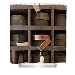 Shower Curtain featuring the photograph Leather Belt Storage At An Old Mill by Edward Fielding