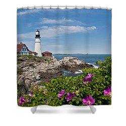 Lighthouse With Rocks On Shore Shower Curtain by Bill Bachmann and Photo Researchers