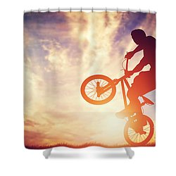 Man Riding A Bmx Bike Performing A Trick Against Sunset Sky Shower Curtain