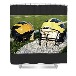 Shower Curtain featuring the photograph One Old, One New Wolverine Helmets On The Field by Michigan Helmet