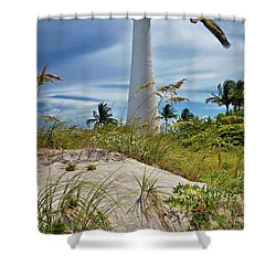 Pelican Flying Over Cape Florida Lighthouse Shower Curtain by Justin Kelefas