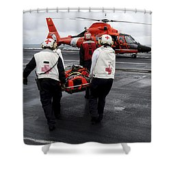 Personnel Carry An Injured Sailor Shower Curtain by Stocktrek Images
