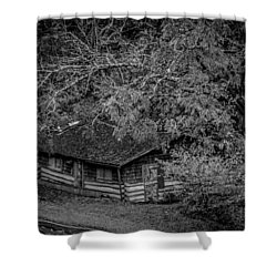 Shower Curtain featuring the photograph Rustic Log Cabin In Black And White by Kelly Hazel