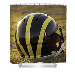 Shower Curtain featuring the photograph Striped Wolverine Helmet On The Field At Dawn by Michigan Helmet