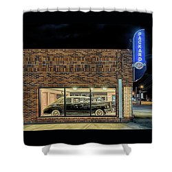 Shower Curtain featuring the photograph The Old Packard Dealership by Susan Rissi Tregoning