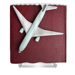 Shower Curtain featuring the photograph Toy Airplane Over Red Book Cover by Edward Fielding
