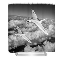 Shower Curtain featuring the photograph Two Avro Vulcan B1 Nuclear Bombers Bw Version by Gary Eason