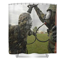 U.s. Air Force Soldier Decontaminates Shower Curtain by Stocktrek Images
