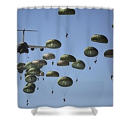 Shower Curtain featuring the photograph U.s. Army Paratroopers Jumping by Stocktrek Images