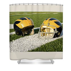 Shower Curtain featuring the photograph Wolverine Helmets From Different Eras On The Field by Michigan Helmet