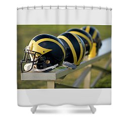 Shower Curtain featuring the photograph Wolverine Helmets On A Bench by Michigan Helmet