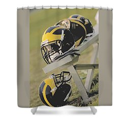 Shower Curtain featuring the photograph Wolverine Helmets On A Football Bench by Michigan Helmet