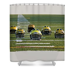 Shower Curtain featuring the photograph Wolverine Helmets Throughout History On The Field by Michigan Helmet