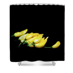 Yellow Chillies On A Black Background Shower Curtain