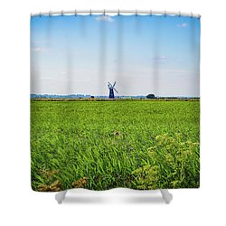 Shower Curtain featuring the photograph Green Grass Field With Windmill On Horizon by Scott Lyons