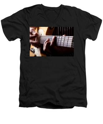 Men's V-Neck T-Shirt featuring the photograph Close Up Shot Of A Man Playing Guitar by Kyle Lee