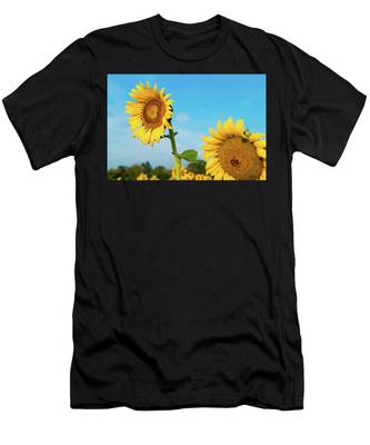 Men's T-Shirt (Athletic Fit) featuring the photograph Blooming Sunflower In Blue Sky by Dennis Dame
