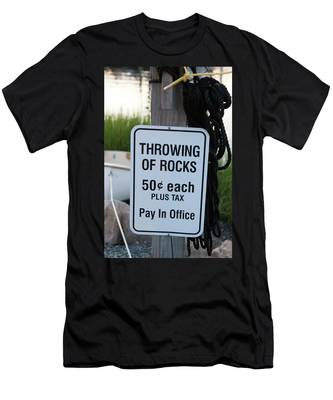 Men's T-Shirt (Athletic Fit) featuring the photograph Rock Throwing Charge by Dennis Dame