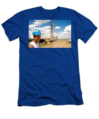 Men's T-Shirt (Athletic Fit) featuring the photograph The Gas Man by Carl Young