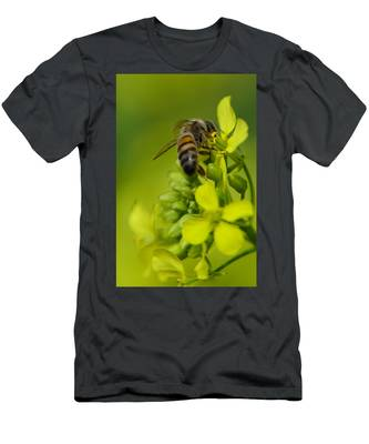 Men's T-Shirt (Athletic Fit) featuring the photograph Bee On A Yellow Background by Michael Goyberg