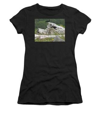 Women's T-Shirt featuring the photograph Dandelion Crow - On Oregon Coast Driftwood  by Cliff Spohn