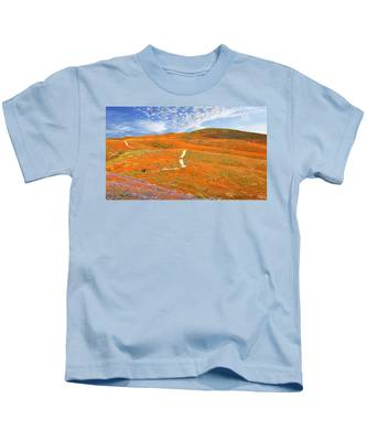 Kids T-Shirt featuring the photograph The Trail Through The Poppies by Endre Balogh