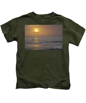 Kids T-Shirt featuring the photograph Soaring Sunset by Bridgette Gomes