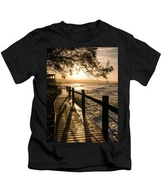 Sunset Over Ocean Walkway Kids T-Shirt