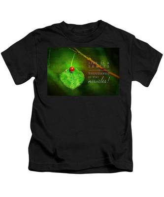 Ladybug On Leaf Thousand Miracles Quote Kids T-Shirt