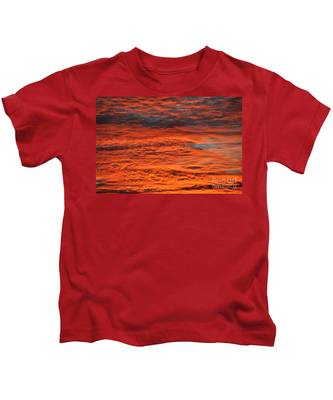 Kids T-Shirt featuring the photograph Sky Fire  by Bridgette Gomes