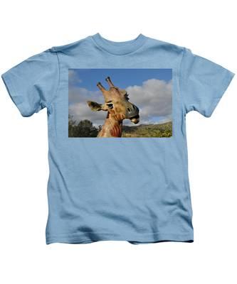 Kids T-Shirt featuring the photograph Giraffe by Bridgette Gomes