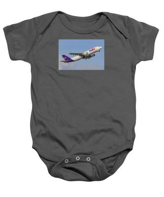 Baby Onesie featuring the photograph Fedex Airplane by Dart and Suze Humeston