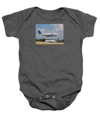 Baby Onesie featuring the photograph Jetblue Over Spirit Air by Dart and Suze Humeston