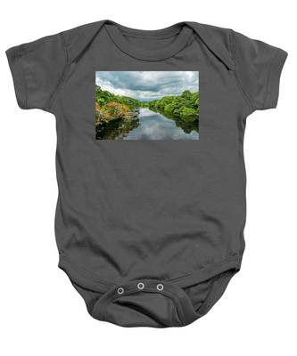Cloudy Skies Over The River Baby Onesie