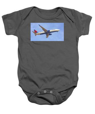 Baby Onesie featuring the photograph Delta Airline by Dart and Suze Humeston