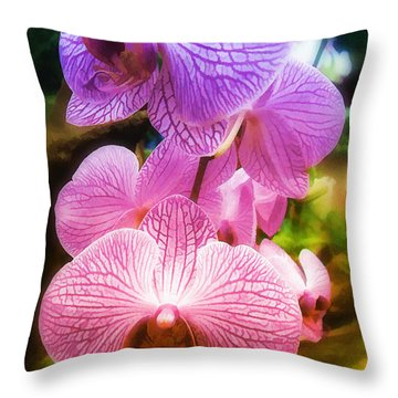 Throw Pillow featuring the photograph  Rainbow Orchids by Elaine Manley