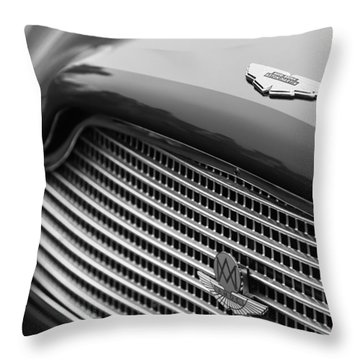 1960 Aston Martin Db4 Gt Coupe' Grille Emblem Throw Pillow by Jill Reger