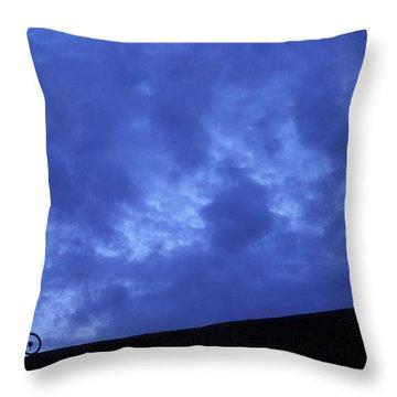 A Silhouette Of A Woman Mountain Biking Throw Pillow