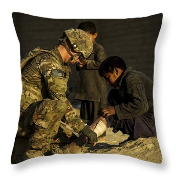 Airman Provides Medical Aid To A Local Throw Pillow by Stocktrek Images