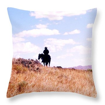 Cowboy Riding Away Throw Pillow