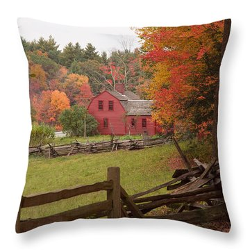 Fall Foliage Over A Red Wooden Home At Sturbridge Village Throw Pillow by Jeff Folger