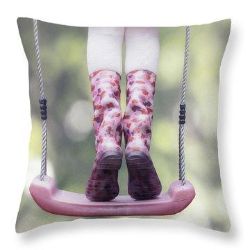 Girl Swinging Throw Pillow by Joana Kruse