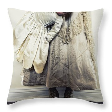 Hand Holding Throw Pillow