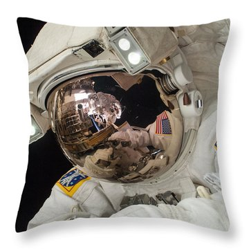 Iss Expedition 38 Spacewalk Throw Pillow by Science Source