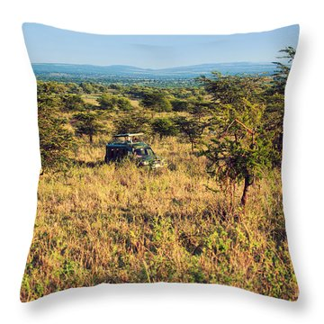 Jeep With Tourists On Safari In Serengeti. Tanzania. Africa. Throw Pillow by Michal Bednarek