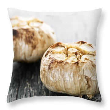 Roasted Garlic Bulbs Throw Pillow by Elena Elisseeva